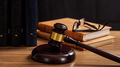 Judge gavel on a wooden desk, law books background - PhotoDune Item for Sale
