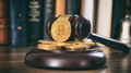 Judge or auction gavel and bitcoins on a wooden desk - PhotoDune Item for Sale
