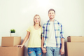 smiling couple with big boxes moving to new home - PhotoDune Item for Sale
