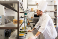 happy male chef cooking food at restaurant kitchen - PhotoDune Item for Sale