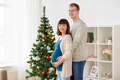 pregnant wife with husband at home at christmas