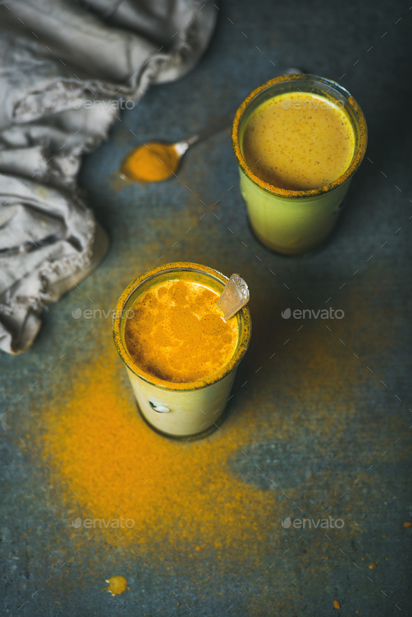 Golden milk with turmeric powder in glasses, energy boosting drink - Stock Photo - Images