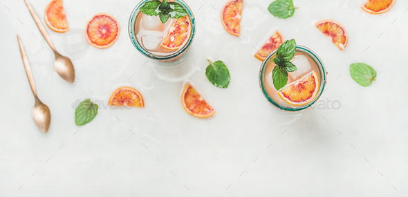 Homemade blood orange lemonade with mint and ice cubes - Stock Photo - Images
