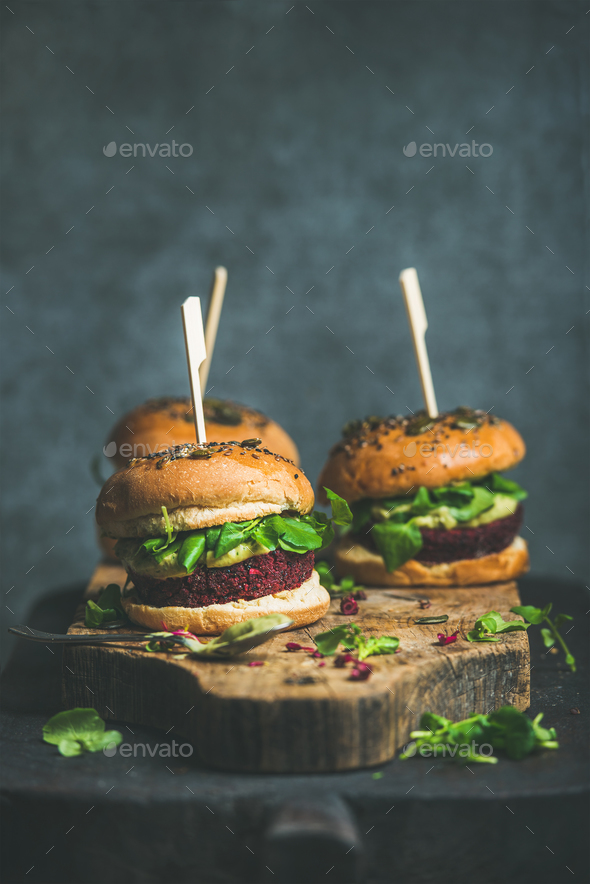 Healthy vegan burger with beetroot-quinoa patty and arugula leaves - Stock Photo - Images