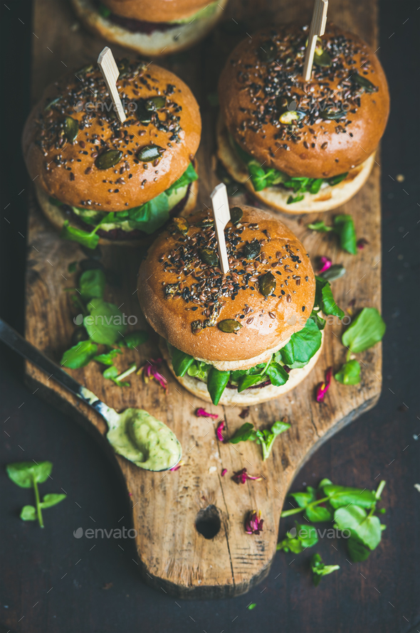 Healthy homemade vegan burger with beetroot-quinoa patty on wooden board - Stock Photo - Images