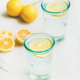 Detox lemon water in glasses served with fresh lemons - PhotoDune Item for Sale