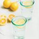Detox lemon water in glasses served with fresh lemons - PhotoDune Item for Sale