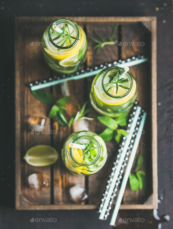 Citrus and herbs infused sassi water in wooden tray - Stock Photo - Images