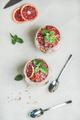 Healthy breakfast with yogurt, granola, orange layered parfait in glasses