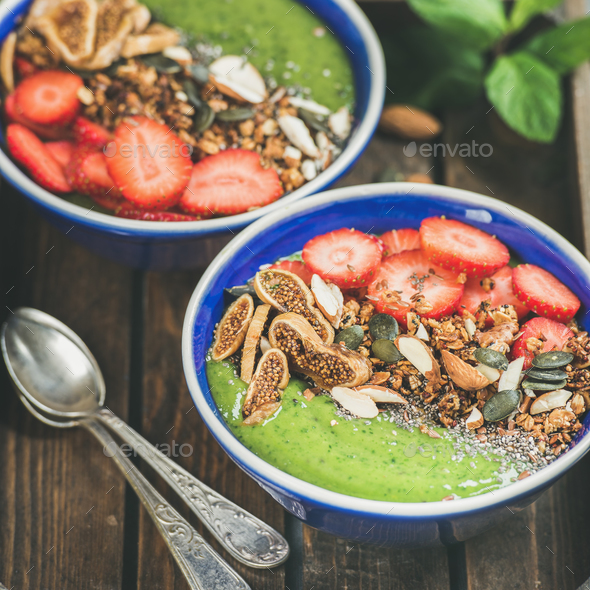 Healthy breakfast, Green smoothie bowls with granola, fruit, nuts - Stock Photo - Images