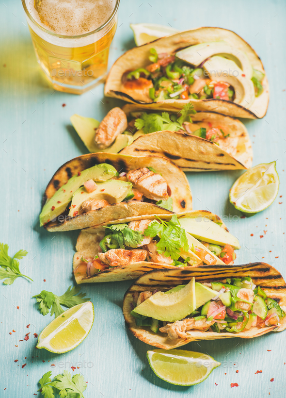 Healthy corn chicken and avocado tortillas, beer in glass - Stock Photo - Images