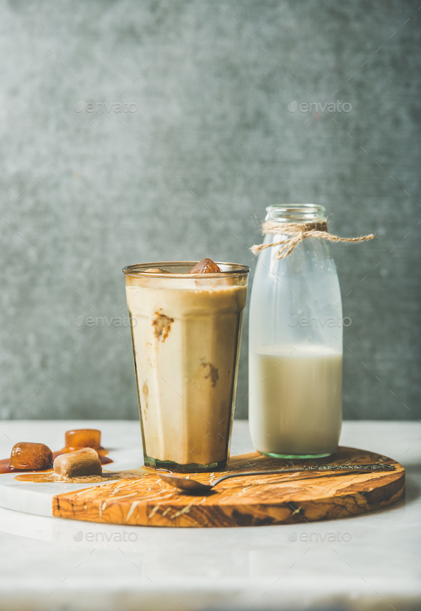 Iced caramel latte coffee cocktail and milk in bottle - Stock Photo - Images