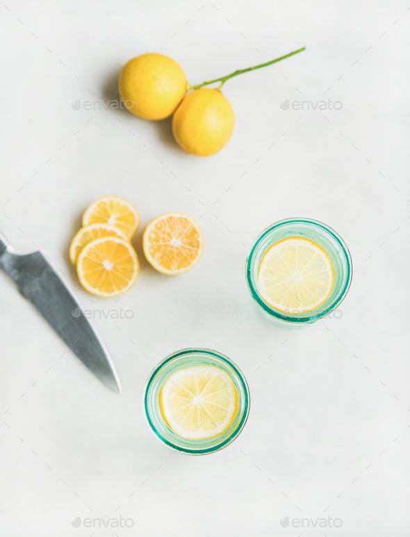 Detox lemon water in glasses and fresh lemons, top view - Stock Photo - Images