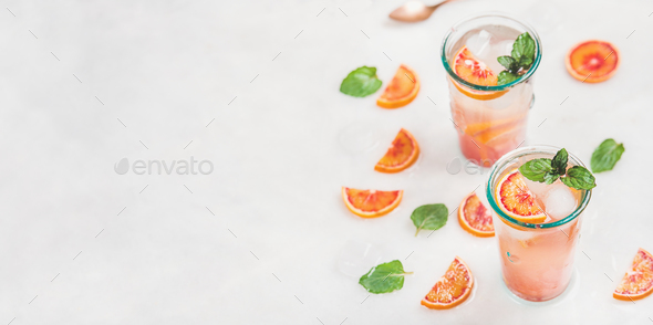 Homemade blood orange lemonade with mint and ice - Stock Photo - Images