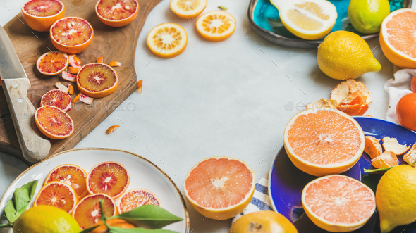 Natural fresh citrus fruits in ceramic plates and wooden board - Stock Photo - Images
