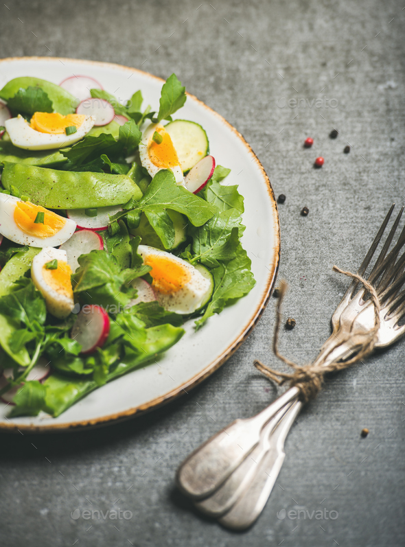 Healthy spring green salad with vegetables, pea and boiled egg - Stock Photo - Images