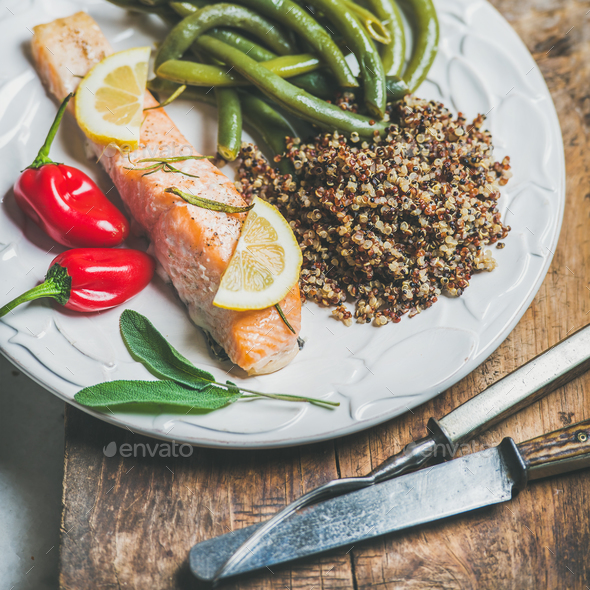 Roasted salmon with quinoa, chilli pepper and poached beans - Stock Photo - Images