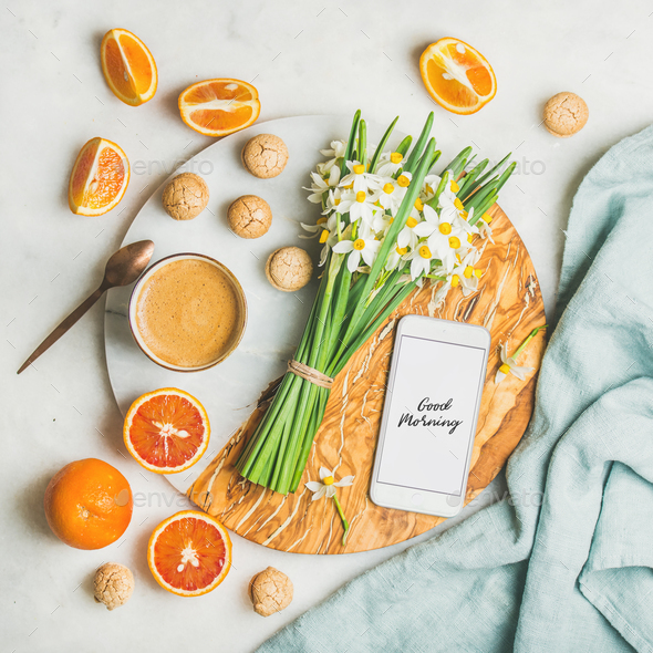 Coffee, cookies, oranges, flowers and mobile phone with Good morning - Stock Photo - Images