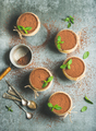 Homemade Tiramisu in individual glasses with mint, copy space