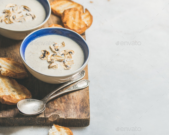 Healthy dinner with creamy mushroom soup and bread, copy space - Stock Photo - Images
