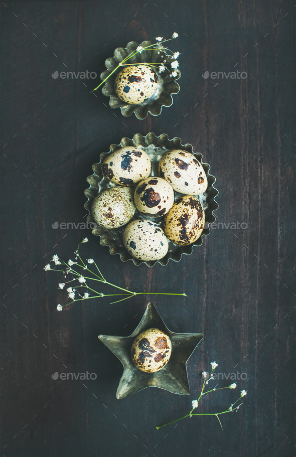 Quail eggs in metal molds and dried flowers for Easter - Stock Photo - Images