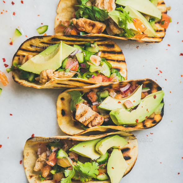 Healthy corn tortillas with grilled chicken fillet, avocado, fresh salsa - Stock Photo - Images