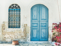 Exterior of Greek island traditional street with blue door, Kast - PhotoDune Item for Sale