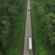Trucks Driving on the Highway at Cloudy Sky