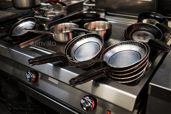 Metal black pans on restaurant kitchen - Stock Photo - Images