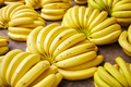 Ripe banana bunches on a local market. - PhotoDune Item for Sale