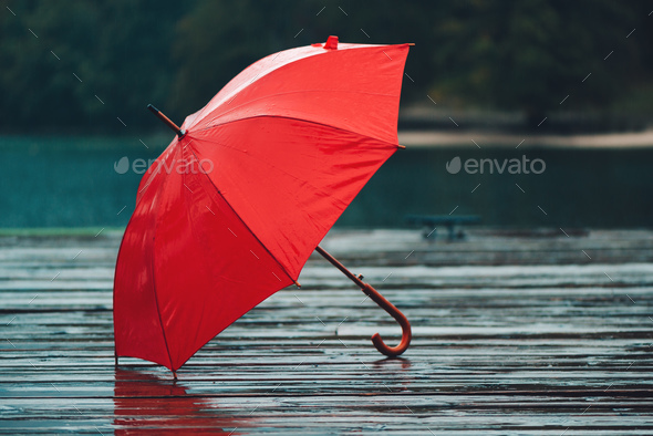 Red umbrella on rain - Stock Photo - Images