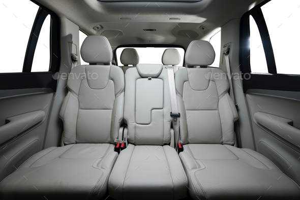 back seats of modern luxury car, white perforated leather interior - Stock Photo - Images
