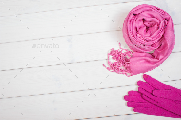Pink shawl and gloves for woman, clothing for autumn or winter, copy space for text - Stock Photo - Images