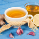 Cup of tea with lemon and ingredients for preparation warming beverage for autumn or winter - PhotoDune Item for Sale