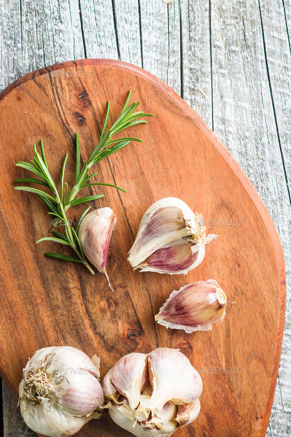 Fresh healthy garlic with rosemary. - Stock Photo - Images