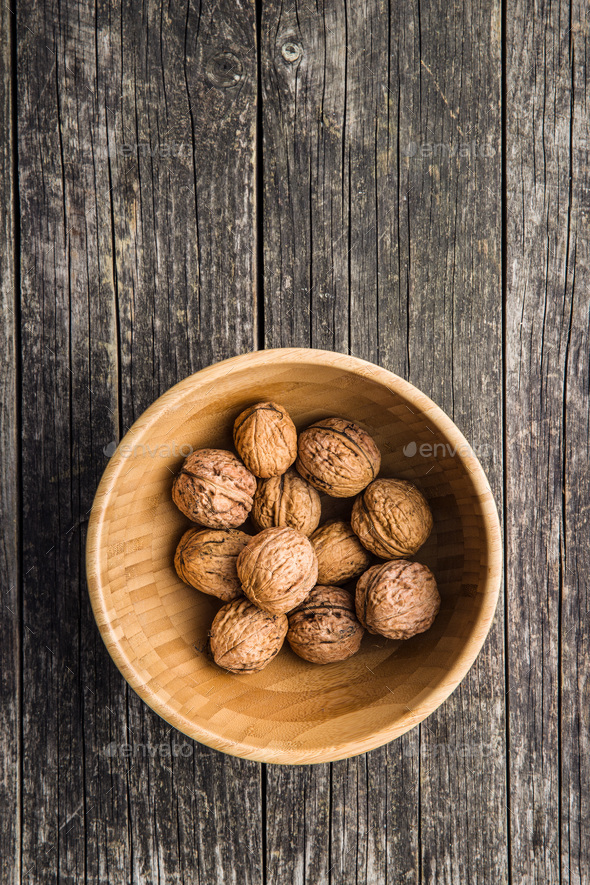 Tasty dried walnuts in bowl. - Stock Photo - Images