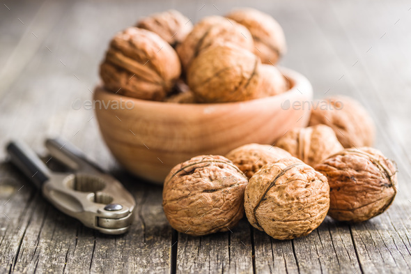 Tasty dried walnuts and nutcracker. - Stock Photo - Images
