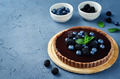 Chocolate tart with blackberries and blueberries