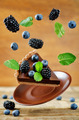 Flying chocolate tart with blackberries and blueberries