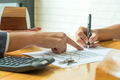 Buyers are signing a home purchase agreement from a broker. - PhotoDune Item for Sale