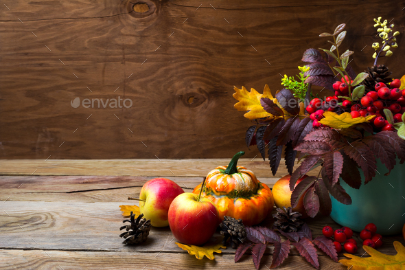 Thanksgiving arrangement with rowan in turquoise vase, copy spac - Stock Photo - Images
