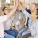 Colleagues High-fiving After Discussion