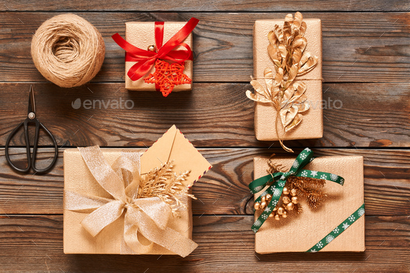 Christmas presents on wooden background - Stock Photo - Images