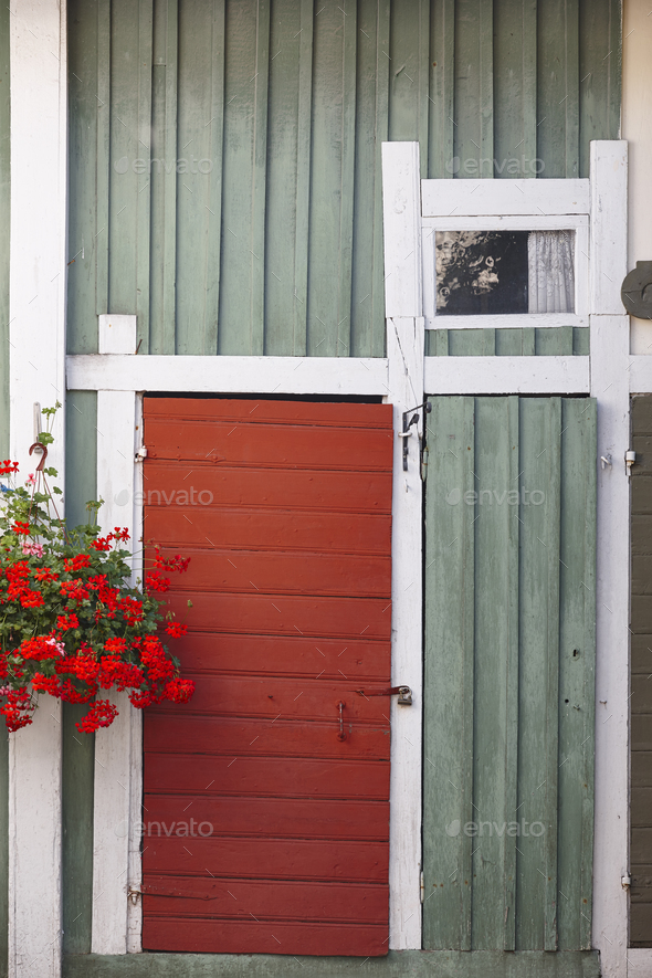 Traditional rusted finland wooden facade in green and red color - Stock Photo - Images
