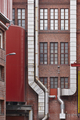 Antique red brick factory building facade in Tampere. Finland. Vertical