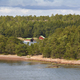 Traditional farm in the finnish forest surrounded by lake. Finland  - PhotoDune Item for Sale