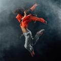 Performer dancing on dark background - PhotoDune Item for Sale