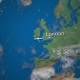 Route of Commercial Airplane Flying From London To New York on the Earth Globe