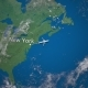 Route of Commercial Airplane Flying From New York To Milan on the Earth Globe