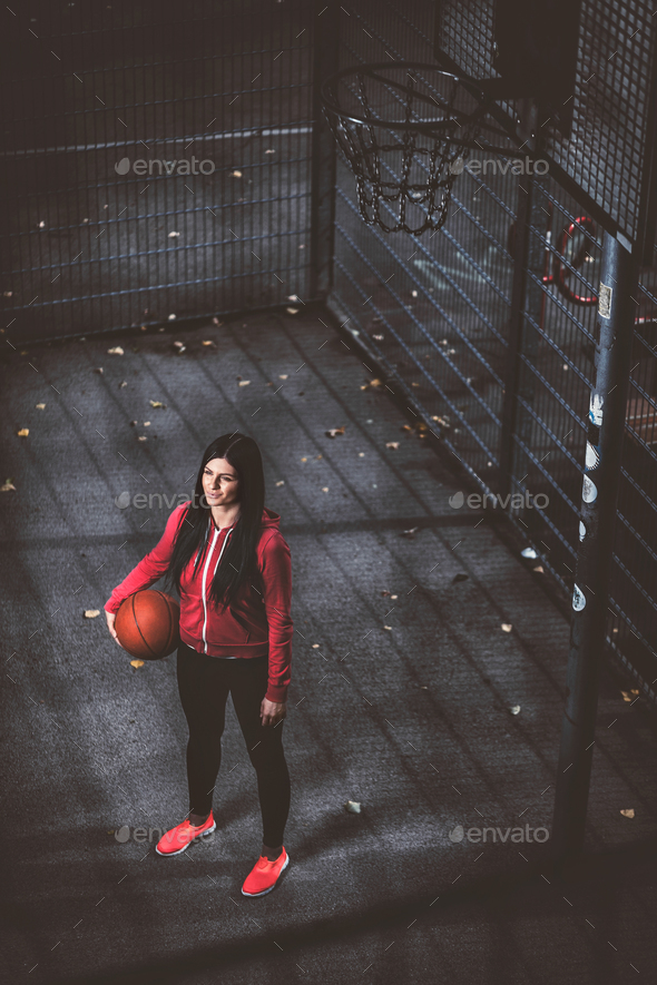 Female basketball player training outdoors on a local court - Stock Photo - Images
